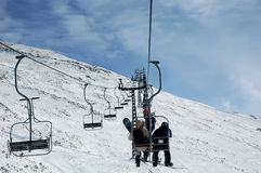 On ski lift. Going up by ski lift Royalty Free Stock Photos