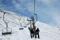 On ski lift. Going up by ski lift royalty free stock photos