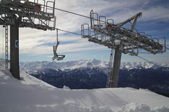 Ski lift against panoramic view of mountain range Royalty Free Stock Photography