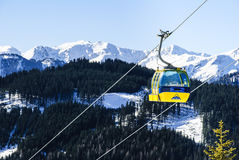 Ski lift in Alps. Ski lift located in valley Serfaus-Fiss-Ladis. With panoramic view to mountains Stock Photo