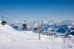 Ski lift in alps mountains. Full ski season Stock Image