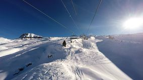 A Ski lift ascending a mountain in the  Alps, stock video