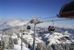 Ski lift austria. Ski lift overlooking mountain scene Austrian alps Stock Photo