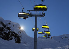 Ski lift backlit with bright sun Royalty Free Stock Images