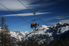 Ski-lift on a blue sky. And big mountain (France Stock Photography