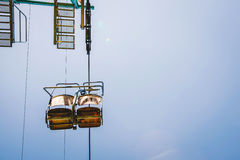 Ski lift with blue sky on the background Royalty Free Stock Photo