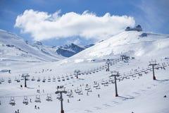 Ski lift on bright winter day Stock Photo