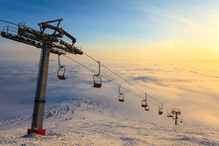 Ski lift on bright winter day Stock Images