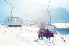 Ski-lift in Bukovel. Bukovel, Ukraine - December 13, 2013: Skiers on a ski-lift in Bukovel. Bukovel - is the largest ski resort in Ukraine. In 2012 it was named royalty free stock images