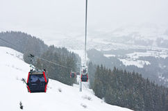 Ski lift cabins against of Kirhberg Royalty Free Stock Image
