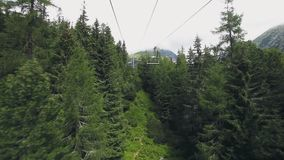 View from ski-lift cable car in Tatra mountains stock video footage