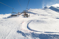 Ski lift, cablechair with skiers on a sunny day in ski resort Royalty Free Stock Images