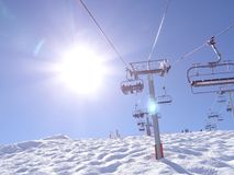 Ski lift carries skiers Royalty Free Stock Image