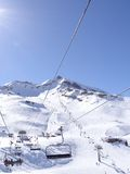 Ski lift carries skiers Stock Image