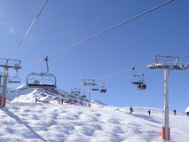 Ski lift carries skiers Royalty Free Stock Photography