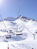 Ski lift carries skiers Stock Images