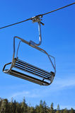 Ski Lift Chair. Closeup of a ski lift chair before the skiers arrive Stock Photos