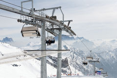 Ski lift chair with skier in mountain Royalty Free Stock Photo