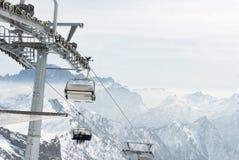 Ski lift chair with skier in mountain Stock Photos