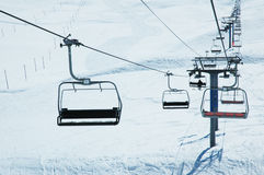 Ski lift chairs. On bright winter day Royalty Free Stock Photography
