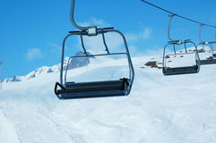 Ski lift chairs. On bright winter day Royalty Free Stock Photos