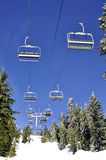 Ski lift chairs against blue sky Royalty Free Stock Photography