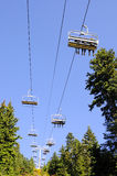 Ski lift chairs against blue sky Royalty Free Stock Images