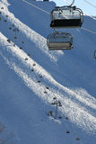 Ski lift chairs on bright winter day Royalty Free Stock Photo
