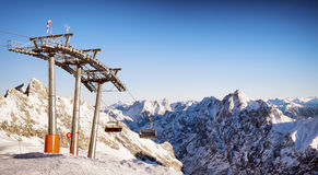 Ski lift chairs. Mountains with modern ski lift chairs Royalty Free Stock Images