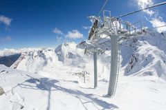 Ski lift chairs in the mountains Royalty Free Stock Image