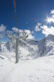 Ski lift chairs in the mountains Royalty Free Stock Images