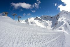 Ski lift chairs in the mountains Stock Photos