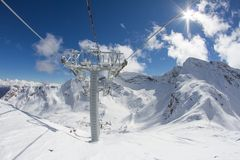Ski lift chairs in the mountains Royalty Free Stock Photography