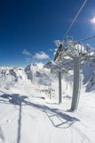 Ski lift chairs in the mountains Royalty Free Stock Photo
