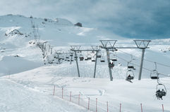 Ski lift chairs on snow in winter stock photography