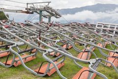 Ski lift chairs waiting to be used in the Alps Stock Photos