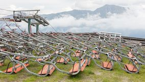 Ski lift chairs waiting to be used in the Alps Royalty Free Stock Photos