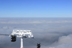 Ski lift. Climb up above the clouds clear day Stock Photography