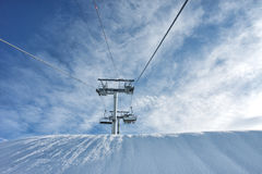 Ski lift with cloudy blue sky Stock Image