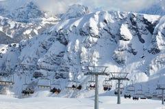 Ski lift in Dolomites Alps, Italy, Europe. Skiers Stock Photos