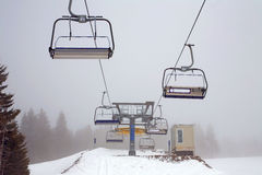 Ski lift in the fog Royalty Free Stock Photos