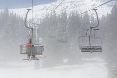 Ski lift in fog Royalty Free Stock Photo