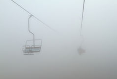 Ski lift in the fog. One of chair lifts in a ski resort in the fog Stock Photos