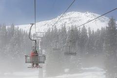 Ski lift in the fog Royalty Free Stock Photos