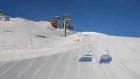 Ski lift. Footage of riding ski lift uphill in Austria stock video footage