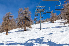 Ski lift in the forest Royalty Free Stock Image