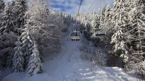 Ski lift going over the mountain stock video