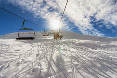 Ski Lift In Mountain With Paths From Skies And Snowboards Stock Images