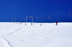 Ski lift instalation. Taking people up on the slope at Sureanu ski resort, Romania Royalty Free Stock Photography