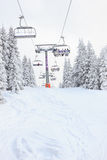 Ski lift in mountain with skies and snowboards people Royalty Free Stock Photos